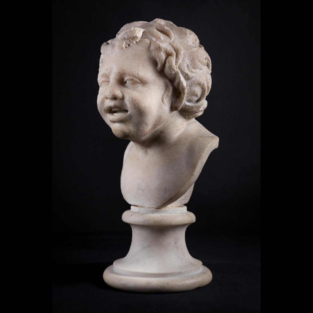 Photo of satyr-head-in-white-marble-lord-spencer-collection-roman