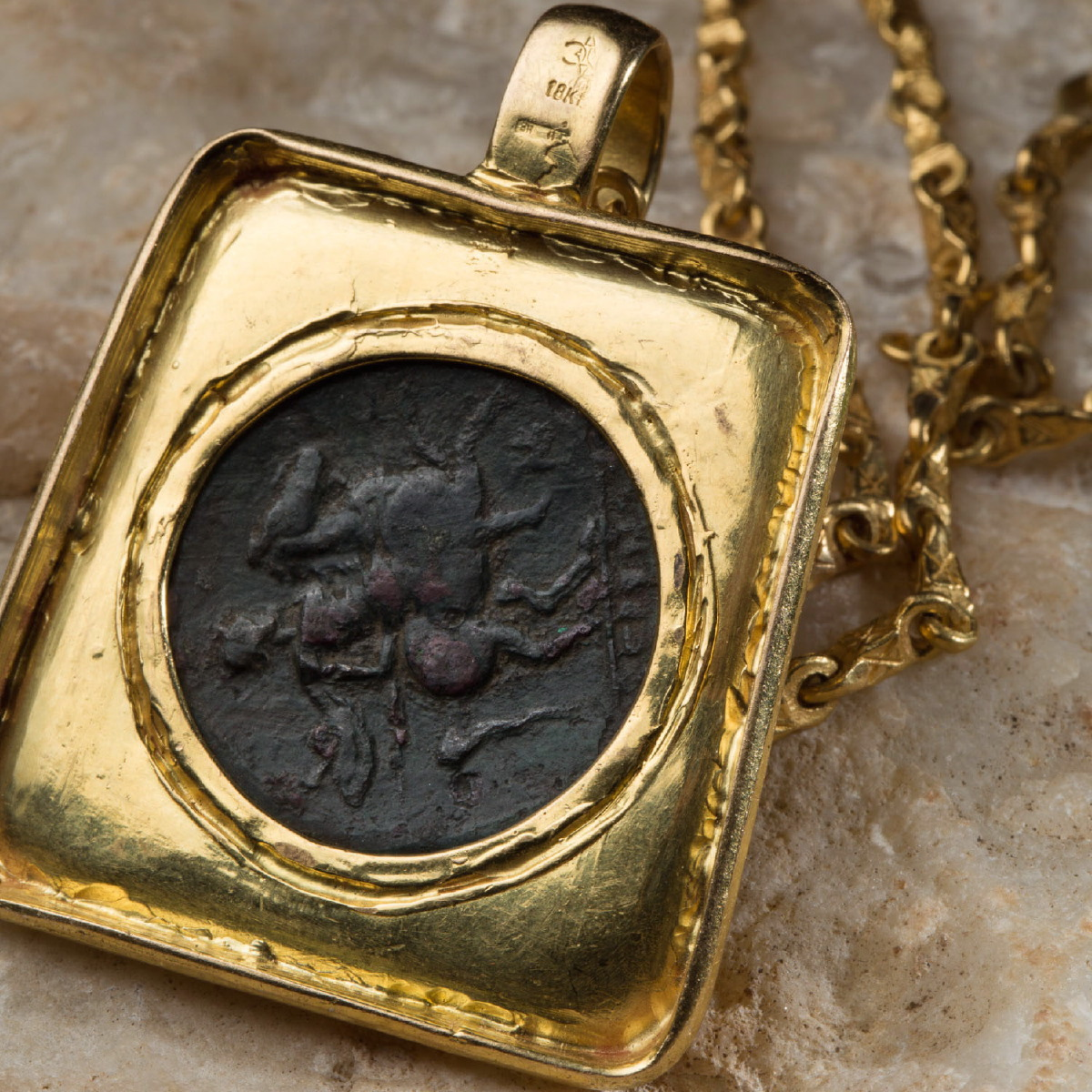 Photo of bronze-coin-from-syracuse-in-a-goldpendant