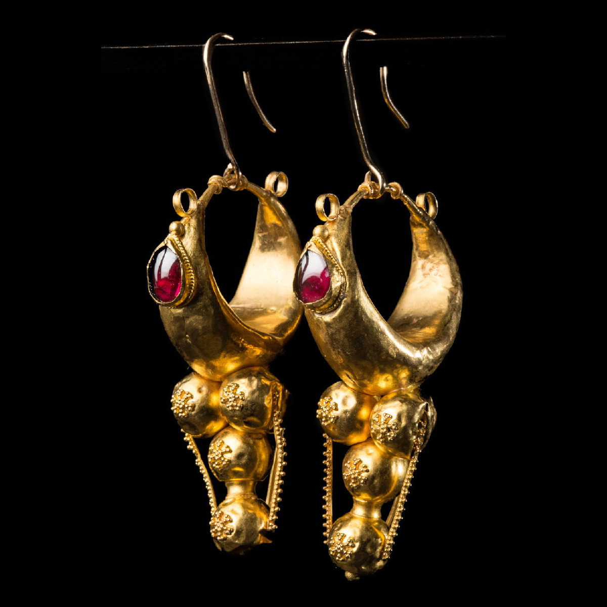 Photo ofANCIENT PAIR OF PHOENICIAN GOLD EARRINGS WITH GARNET