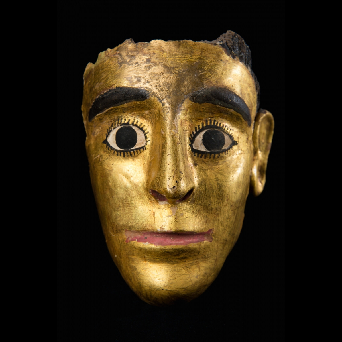 Photo of gold-painted-plaster-mask-old-egypt