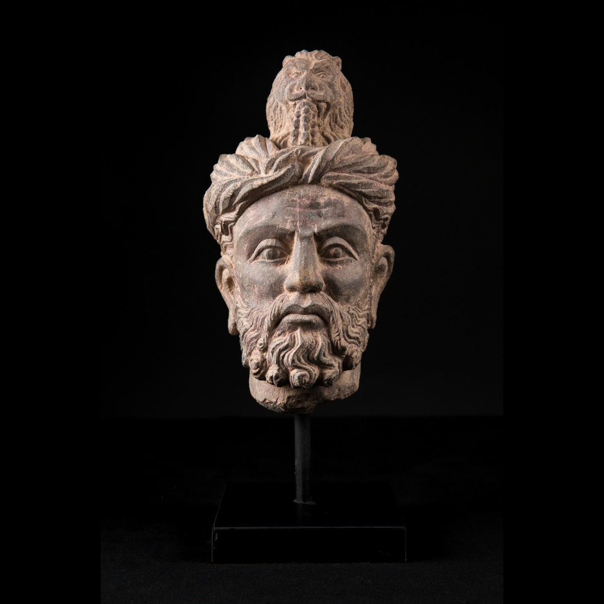 Photo of rare-head-of-a-man-with-lion-greco-buddhist-art-pakistan