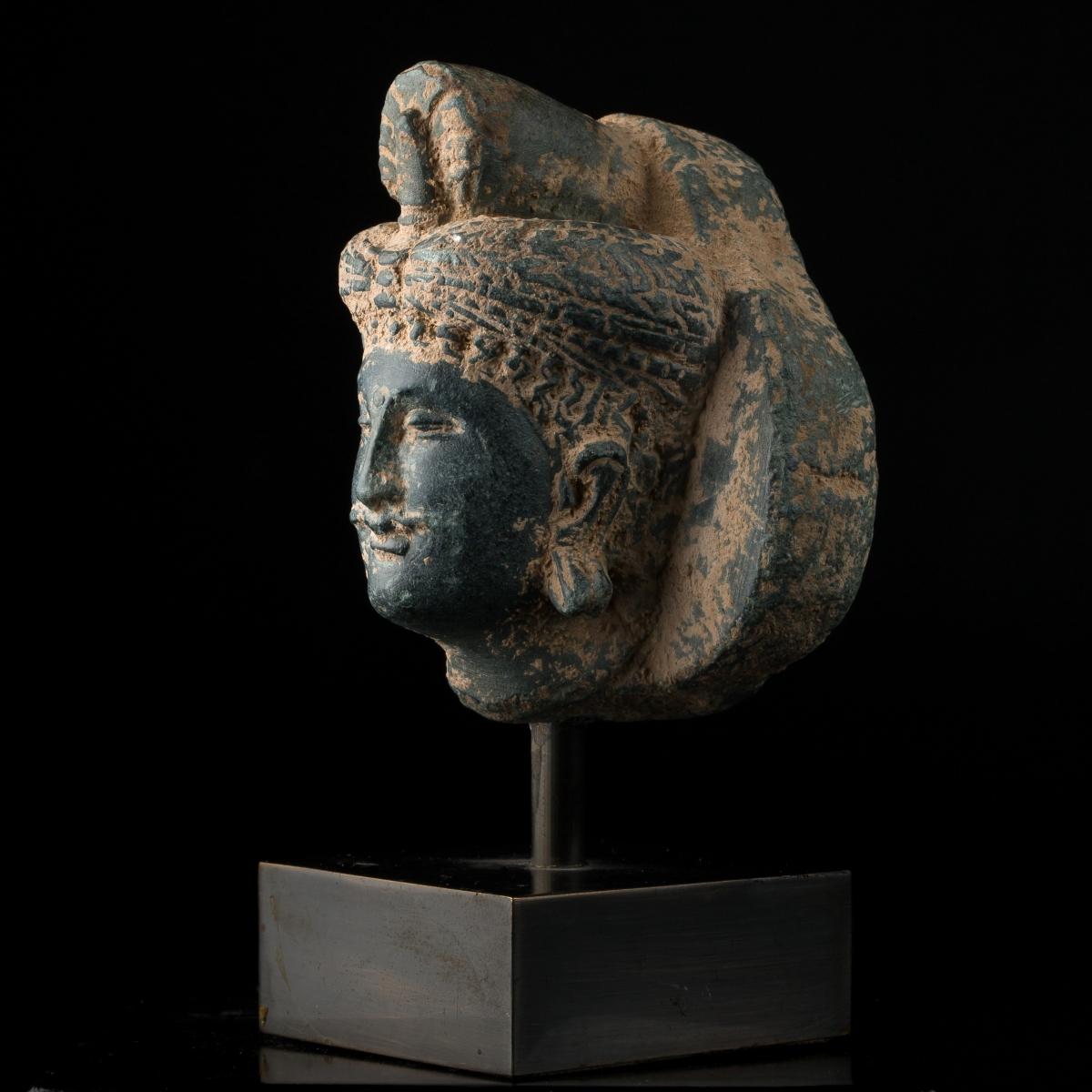 Photo of head-of-a-bodhisattva-in-grey-schist