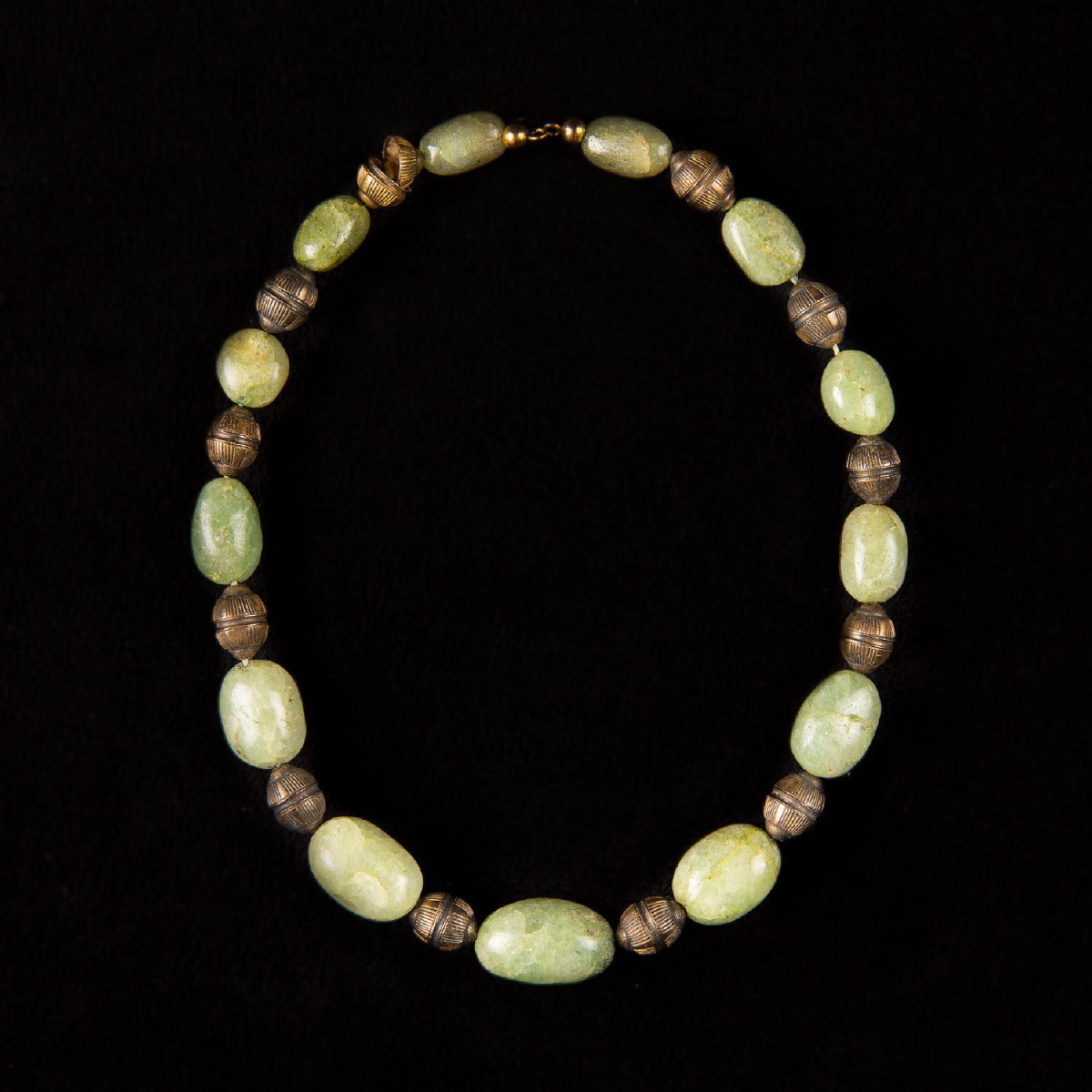 Photo of RARE OLIVINE RITUAL NECKLACE EXHIBITED AT THE METROPOLITAN MUSEUM