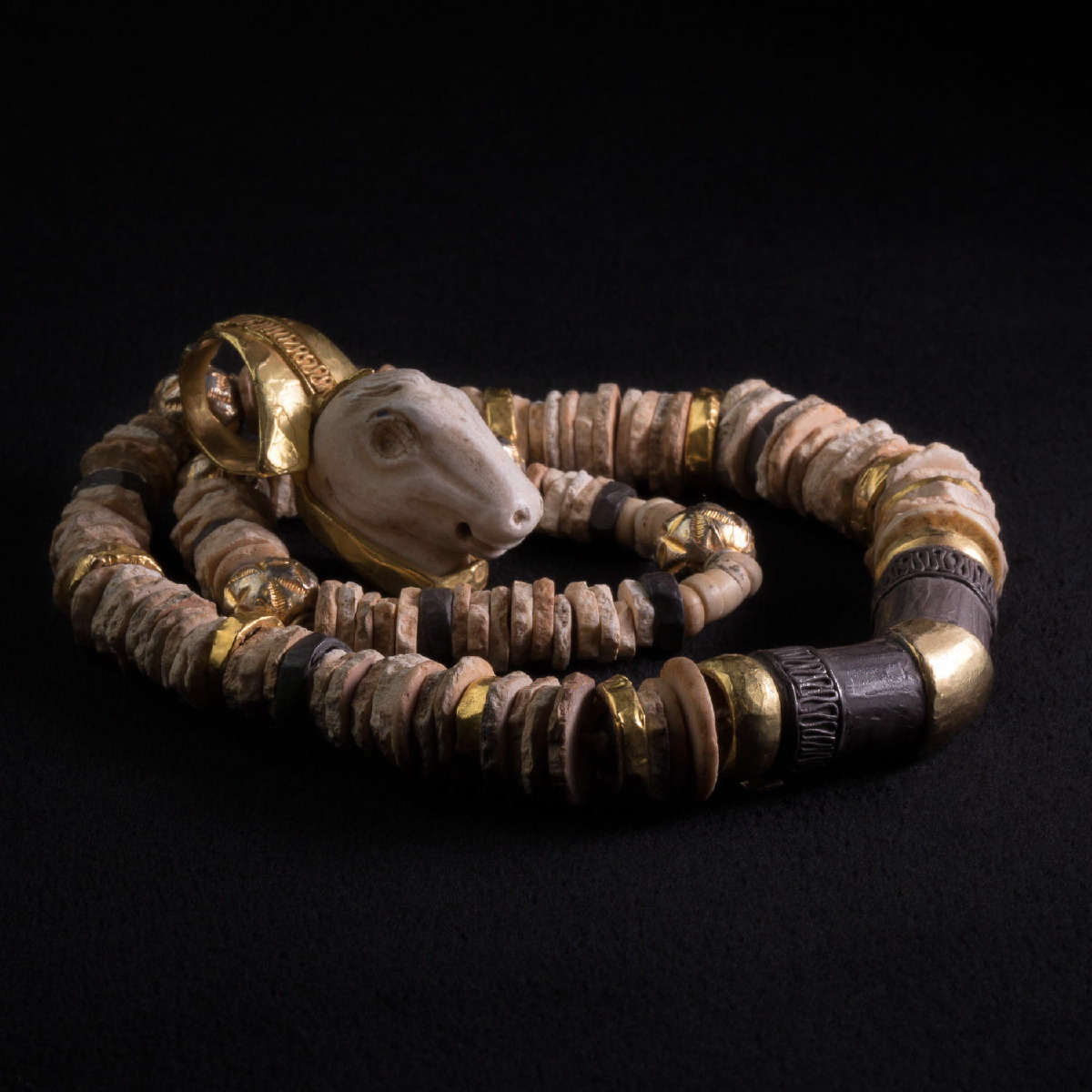 Photo ofROMAN RAM HEAD AND SUMERIAN SHELL NECKLACE
