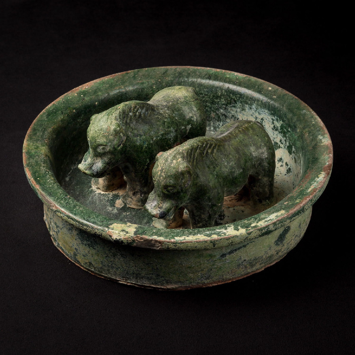 Photo of TWO WILD BOARS ENCLOSED IN A PEN IN GREEN HAN CERAMIC