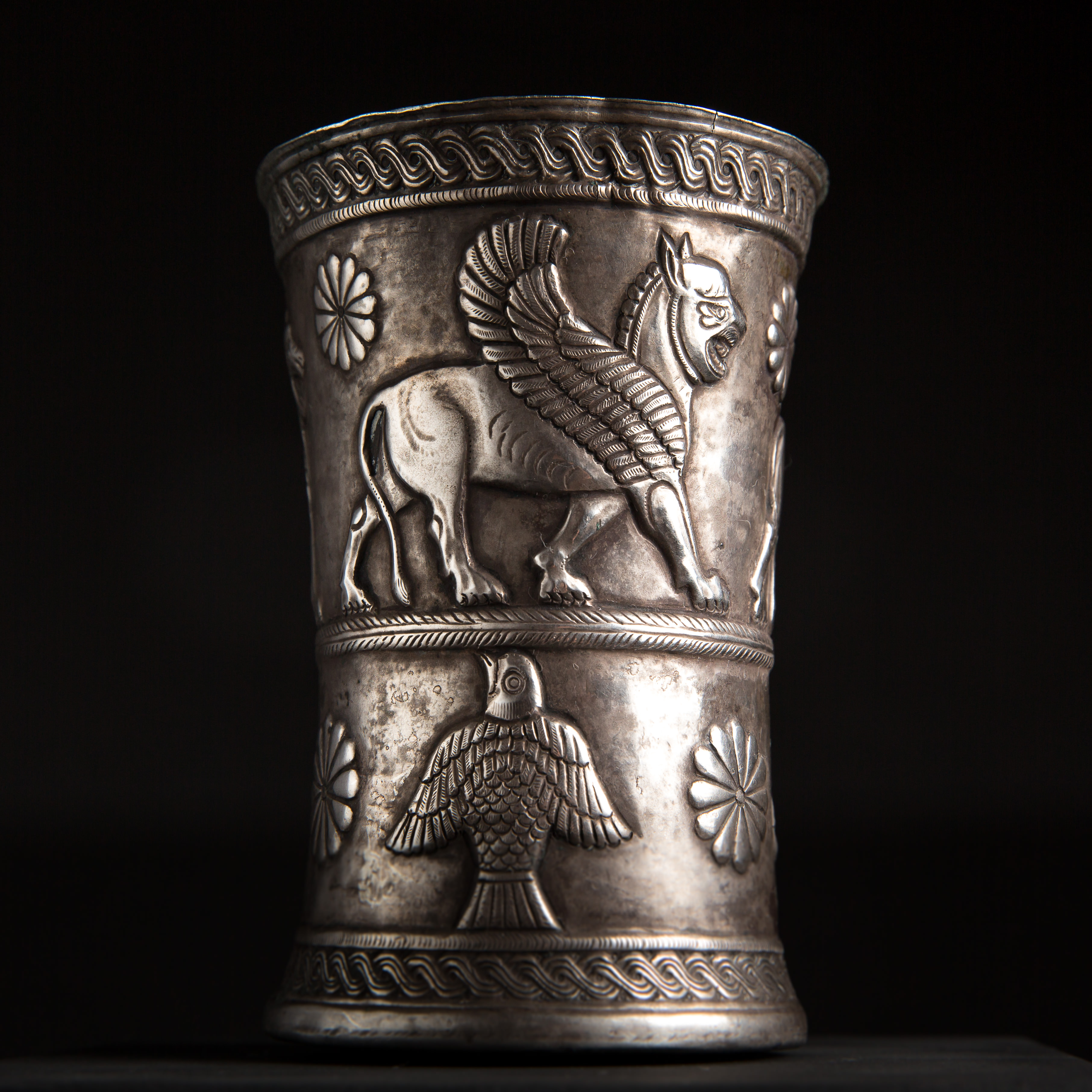Photo of PERSIAN SILVER BEAKER WITH WINGED LIONS