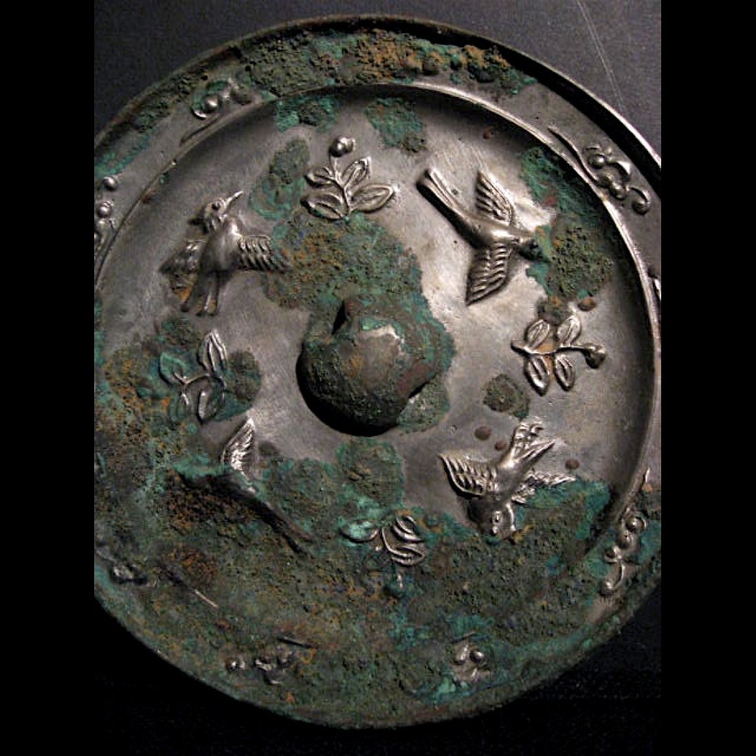 Photo of TANG SILVERED BRONZE MIRROR WITH FLOWERS AND BIRDS